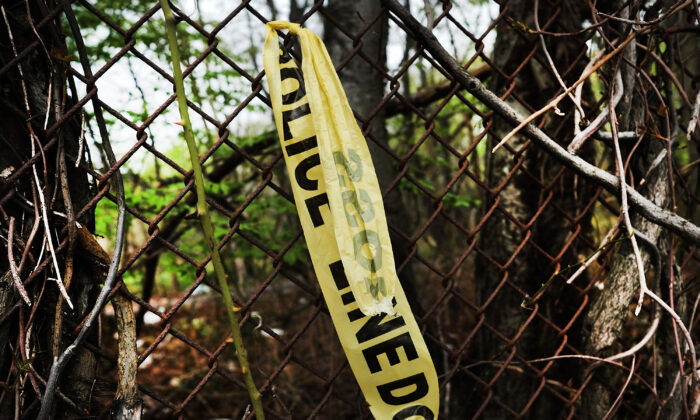Crime scene tape hangs on a fence, in this file photo. (Spencer Platt/Getty Images)