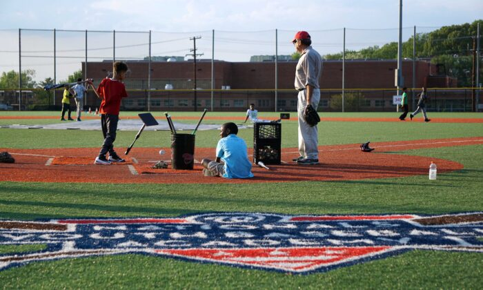 A coach watches children practice their baseball skills at the Nationals Youth Baseball Academy in Washington on May 7, 2018. (Katharyn Gillam/AFP via Getty Images)