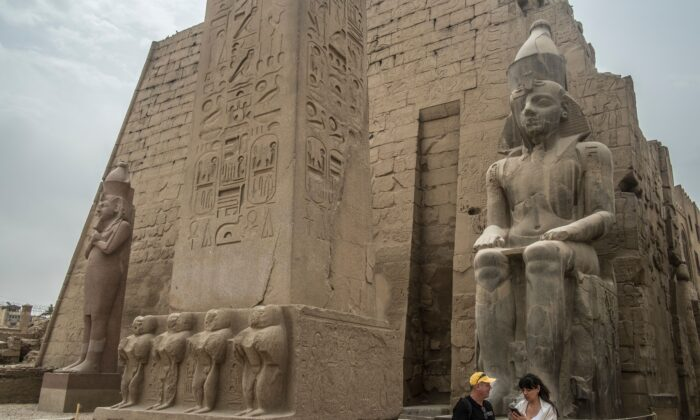 Tourists visit the Luxor Temple in Egypt's southern city of Luxor on March 11, 2020. (Khaled Desouki/AFP via Getty Images)