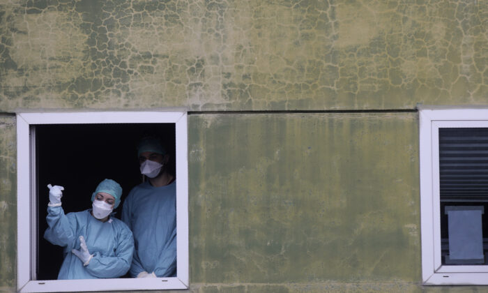 Medical staff at work at one of the emergency structures that were set up to ease procedures at the Brescia hospital, northern Italy, on March 12, 2020. (Luca Bruno/AP Photo)