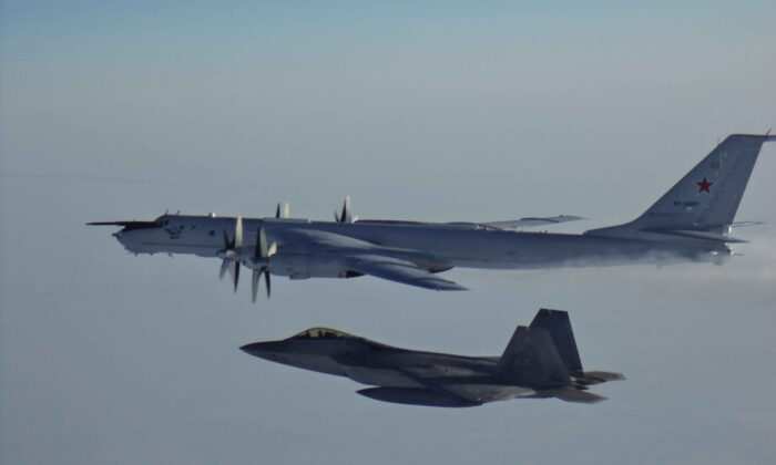 A Russian Tu-142 maritime reconnaissance aircraft escorted by an F-22 after entering the Alaskan Air Defense Identification Zone on  March 9, 2020. (NORAD/DoD)