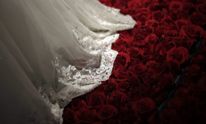 A wedding dress is displayed during a group wedding ceremony hosted by the French Pavilion at the Shanghai World Expo, China, on May 11, 2010. (Aly Song/Reuters)