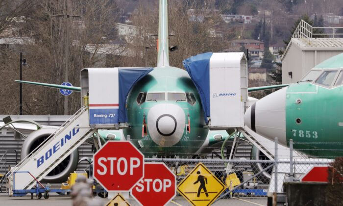 Boeing 737 Max jets sit parked in Renton, Wash., on Dec. 16, 2019. Internal government documents about the Boeing 737 Max are raising new questions about Canada's aircraft approval process. (The Canadian Press/AP, Elaine Thompson)