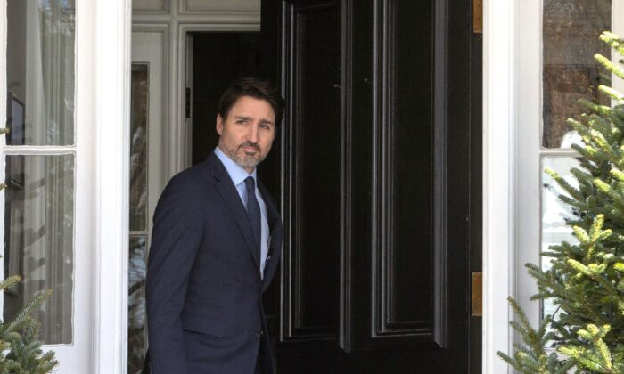 Prime Minister Justin Trudeau emerges from Rideau Cottage, his residence in Ottawa, to hold a news conference on March 13, 2020. (The Canadian Press/Fred Chartrand)