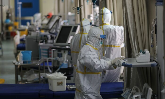 Medical staff members disinfect equipment at a ward used to be an isolation ward for patients infected by the COVID-19 coronavirus at a hospital in Wuhan, China on March 12, 2020. (STR/AFP via Getty Images)