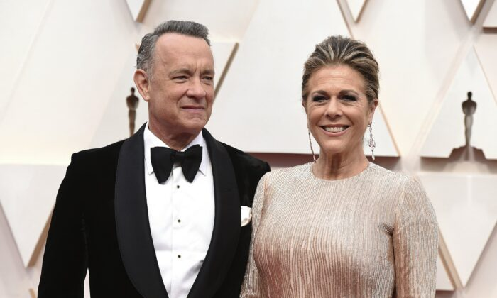 Tom Hanks, left, and Rita Wilson arrive at the Oscars at the Dolby Theatre in Los Angeles on Feb. 9, 2020. (Photo by Jordan Strauss/Invision/AP)