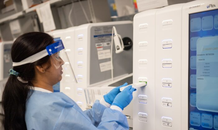 A lab technician begins semi-automated testing for COVID-19 at Northwell Health Labs in Lake Success, New York, on March 11, 2020. (Andrew Theodorakis/Getty Images)