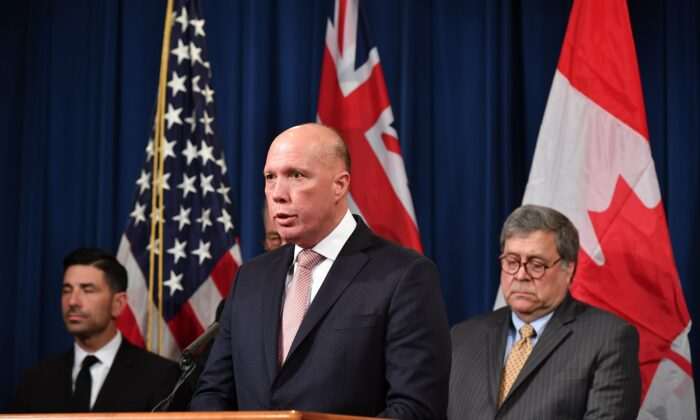 Australia's Minister for Home Affairs Peter Dutton announces measures against online sexual exploitation during a press conference at the Department of Justice in Washington on March 5, 2020. (MANDEL NGAN/AFP via Getty Images)