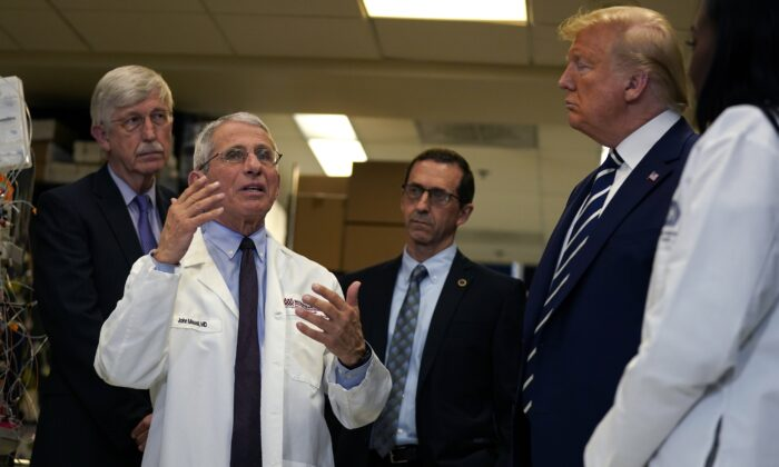 President Donald Trump listens as he tours the Viral Pathogenesis Laboratory at the National Institutes of Health, Tuesday, March 3, 2020, in Bethesda, Md. (AP Photo/Evan Vucci)
