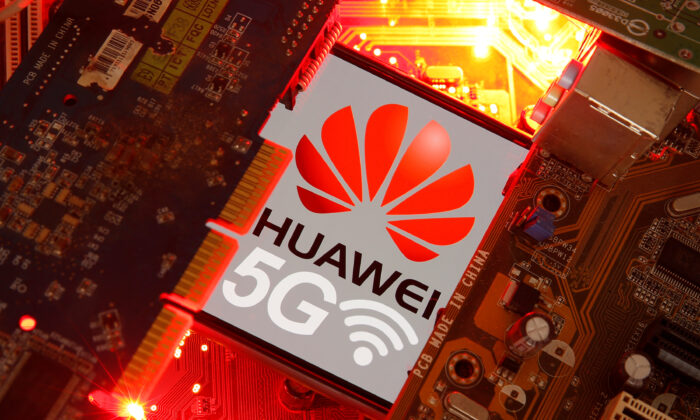 A smartphone with the Huawei and 5G network logo is seen on a PC motherboard in this illustration picture taken on Jan. 29, 2020. (Dado Ruvic/Illustration/Reuters)