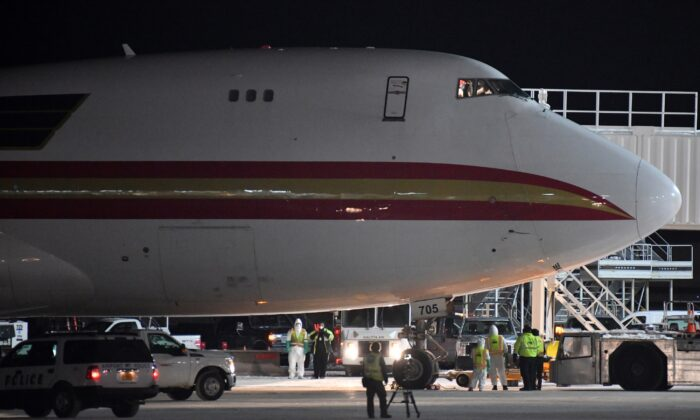 A plane carrying Americans evacuated from Wuhan, China arrives at Ted Stevens Anchorage International Airport in Anchorage, Alaska on Jan. 28, 2020. The state on March 12, 2020, reported its first confirmed coronavirus case. (Lance King/Getty Images)