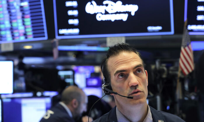 A trader works on the floor of the New York Stock Exchange (NYSE) after the opening bell of the trading session in New York, on March 13, 2020. (Reuters/Lucas Jackson)