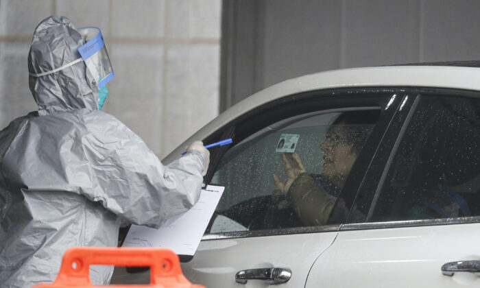 A patient arrives to be tested for COVID-19 at Glen Island Park in New Rochelle, N.Y. on Friday, March 13, 2020. (John Minchillo/AP Photo)