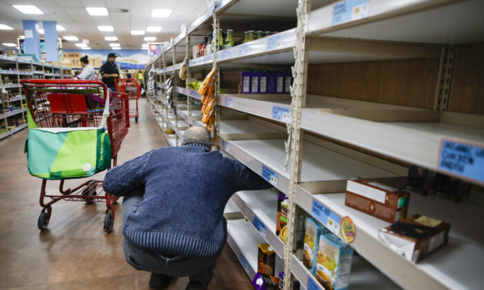 Shoppers browse barren shelves at a supermarket in Larchmont, N.Y. on  March 13, 2020. (John Minchillo/AP Photo)