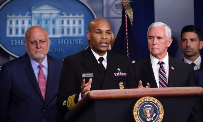 U.S. Surgeon General Jerome Adams (C) speaks about the novel coronavirus alongside Vice President Mike Pence and members of the Coronavirus Task Force in the Brady Press Briefing Room at the White House in Washington on March 9, 2020. (Saul Loeb/AFP via Getty Images)