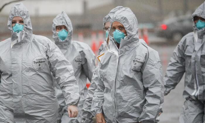 Medical personnel arrive to perform COVID-19 infection testing procedures at Glen Island Park in New Rochelle, N.Y., on March 13, 2020. (John Minchillo/AP Photo)