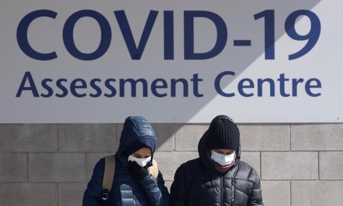People leave a COVID-19 assessment centre in Ottawa, Canada, on March 14, 2020. (Adrian Wyld/The Canadian Press)