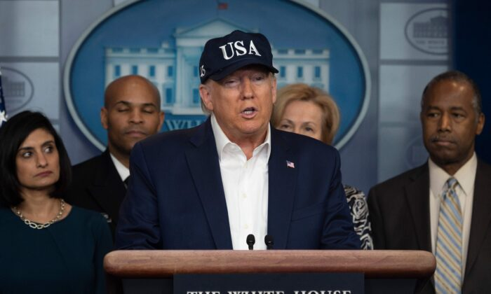 President Donald Trump gives a press briefing about the Coronavirus (COVID-19) alongside members of the Coronavirus Task Force in the Brady Press Briefing Room at the White House in Washington on March 14, 2020. (Jim Watson/AFP via Getty Images)