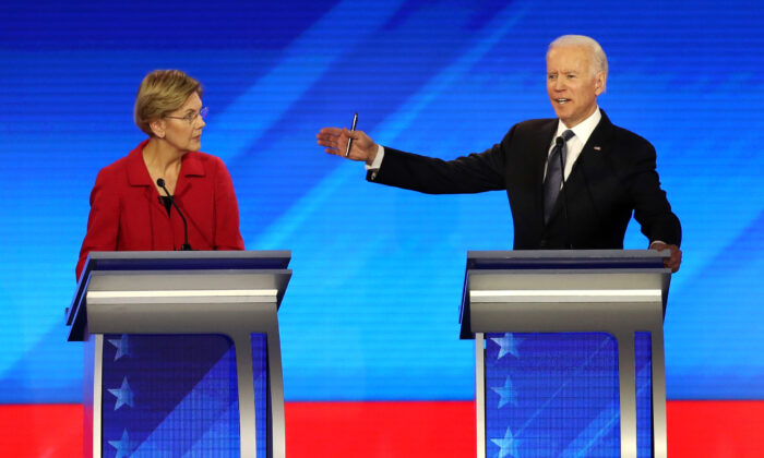 Democratic presidential candidates Sen. Elizabeth Warren (D-Mass.) and former Vice President Joe Biden (R) participate in the Democratic presidential primary debate in the Sullivan Arena at St. Anselm College in Manchester, N.H., on Feb. 7, 2020. (Joe Raedle/Getty Images)