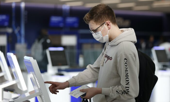 Passenger checks in using a touchscreen at JetBlue's terminal in John F. Kennedy International Airport in New York City on March 14, 2020. (Kathy Willens/AP Photo)