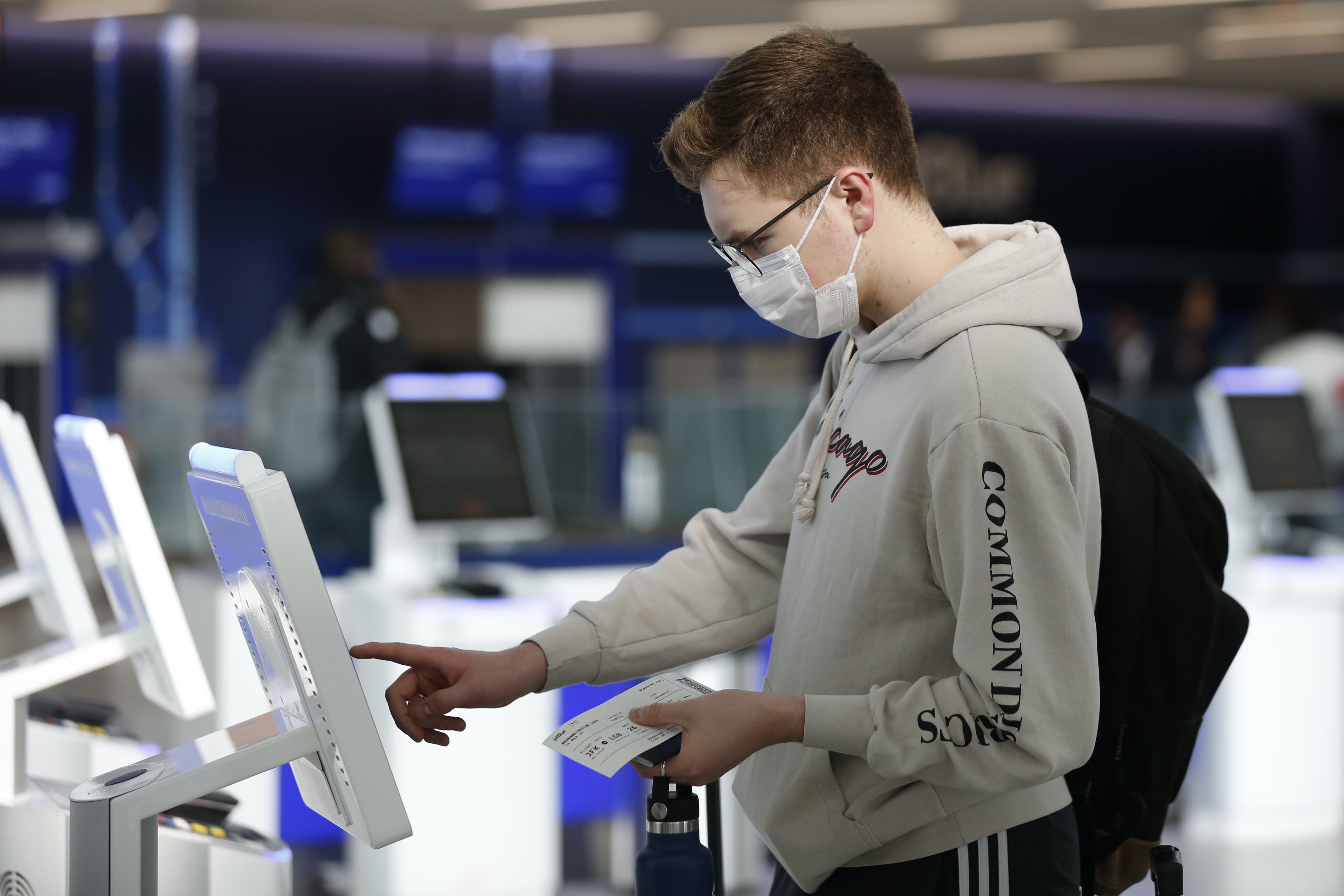 Passenger checks in using a touchscree