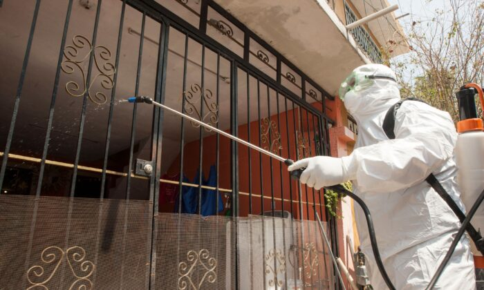 A paramedic from Escobedo, disinfects a house during a coronavirus drill, in Escobedo Nuevo Leon, Mexico, on March 15, 2020. (Julio Cesar Aguilar/AFP via Getty Images)