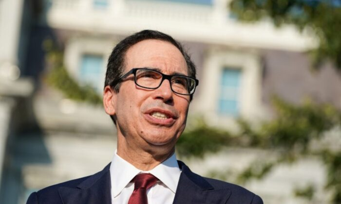 Secretary of the Treasury Steven Mnuchin answers questions from the press after an interview on CNBC on the North Lawn of the White House in Washington, U.S., September 12, 2019. Reuters/Sarah Silbiger.