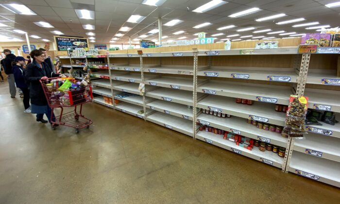 Shelves previously filled with pasta and canned food are seen empty at a Trader Joe's grocery store in Encinitas, Calif., on March 12, 2020. (Mike Blake/Reuters)