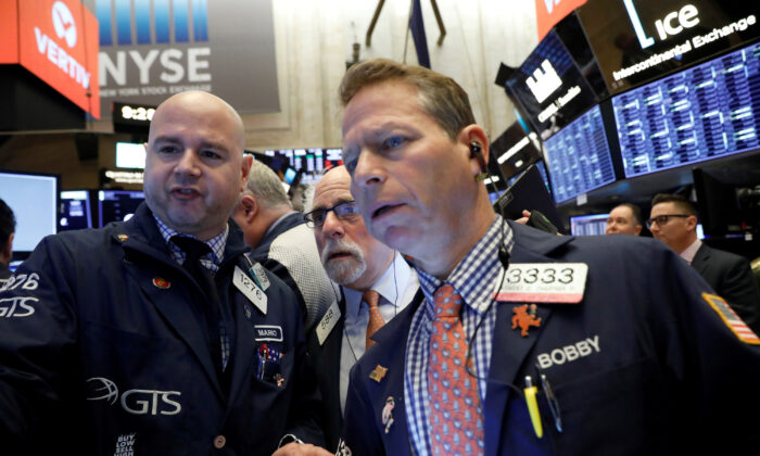 Traders work on the floor at the New York Stock Exchange (NYSE) in New York on Feb. 28, 2020. (REUTERS/Brendan McDermid/File Photo)