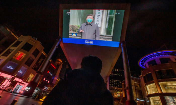 A screen shows a CCTV state media broadcast of Chinese leader Xi Jinping's visit to Wuhan at a shopping center in Beijing, March 10, 2020. (REUTERS/Thomas Peter/File Photo)