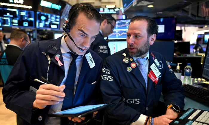 Traders work during the opening bell at the New York Stock Exchange (NYSE) at Wall Street in New York City on March 16, 2020. (Johannes Eisele/AFP via Getty Images)