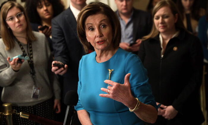 Speaker of the House Rep. Nancy Pelosi (D-Calif.) speaks to members of the media at the Capitol in Washington on March 13, 2020. (Alex Wong/Getty Images)