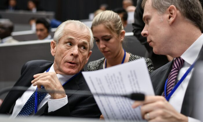 White House trade adviser Peter Navarro (L) attends the opening session of a congress of the Universal Postal Union (UPU) in Geneva on Sept. 24, 2019. (FABRICE COFFRINI/AFP via Getty Images)