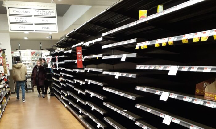 Empty shelves at the Whole Foods supermarket in Midtown Manhattan on March 16, 2020. (Epoch Times staff)