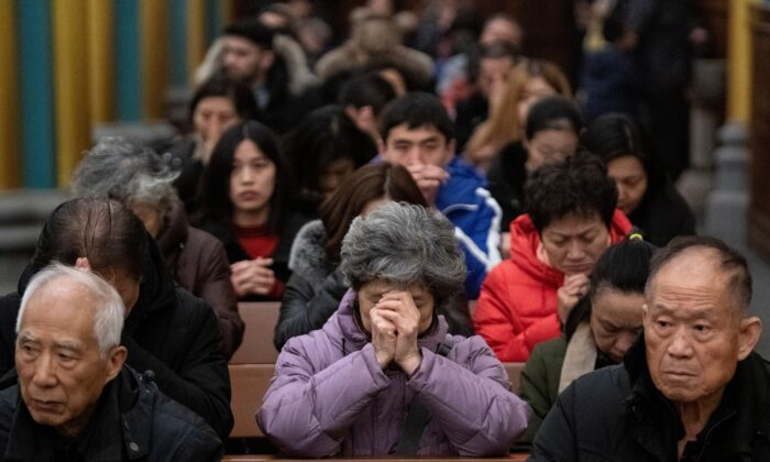 Worshippers attend a mass at the Xishiku Cathedral in Beijing, China in this file photo. (Noel Celsis/AFP via Getty Images)