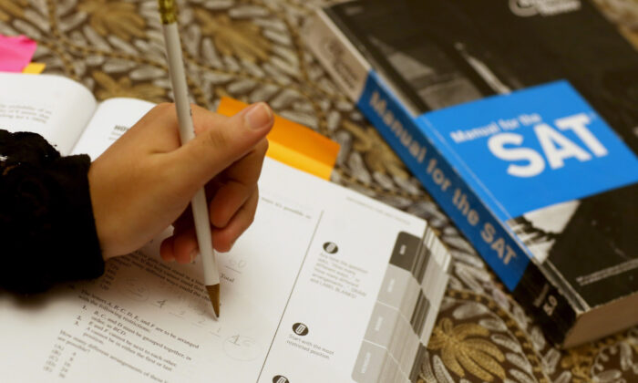 A student uses a Princeton Review SAT Preparation book to study for the test in a file photo. (Joe Raedle/Getty Images)