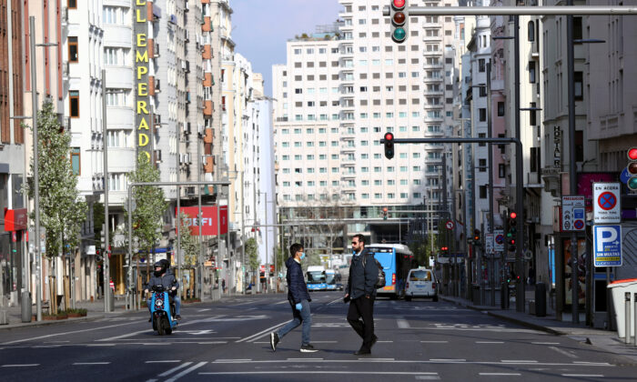The almost empty Gran Via avenue is seen during partial lockdown, as part of a 15-day state of emergency to combat the coronavirus outbreak in Madrid, Spain, March 15, 2020. (Sergio Perez/Reuters)