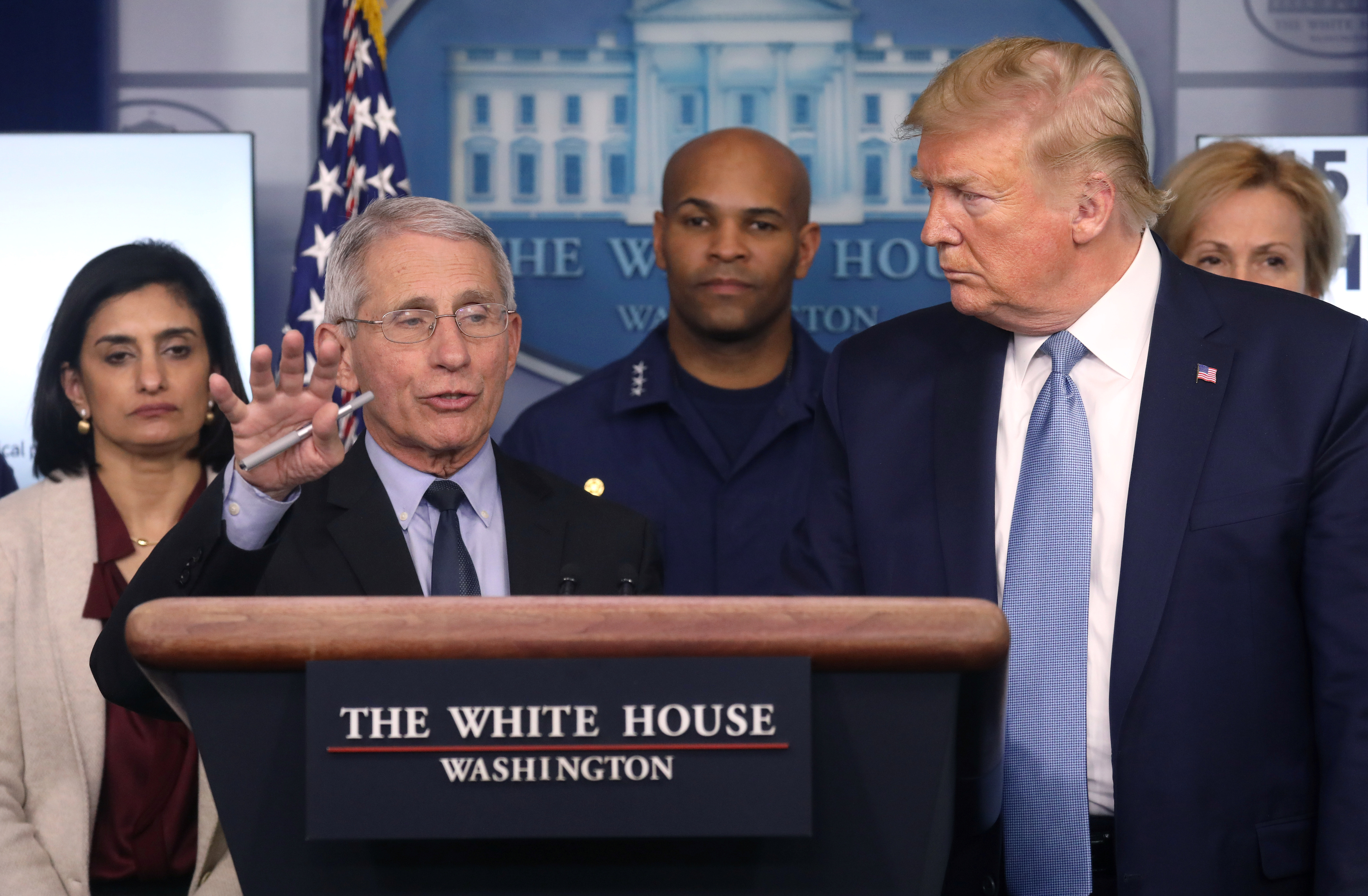 Trump listens to Fauci