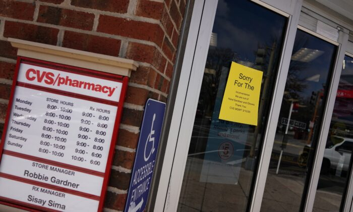 A message is seen on the doors of a CVS pharmacy announces that the store is out of hand sanitizer and gloves in Washington on March 17, 2020. (Mandel Ngan/AFP via Getty Images)