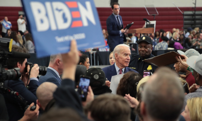 Democratic presidential candidate Joe Biden greets supporters as he leaves a campaign rally at Renaissance High School in Detroit, Michigan, on March 9, 2020. (Scott Olson/Getty Images)