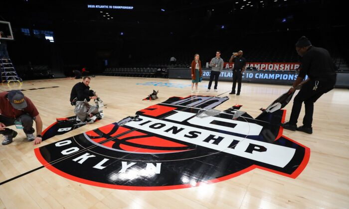 The court is dismantled following the announcement that the 2020 Atlantic 10 Men's Basketball Tournament has been cancelled due to the Wuhan Virus in the Brooklyn Borough of New York City on March 12, 2020. (Mike Stobe/Getty Images)
