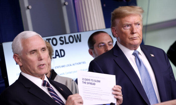 Vice President Mike Pence, joined by members of the Coronavirus Task Force, and President Donald Trump speaks about the coronavirus in the press briefing room at the White House in Washington on March 16, 2020. (Win McNamee/Getty Images)