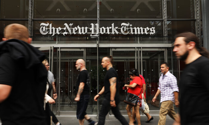 People walk past the New York Times building in New York City on July 27, 2017. (Spencer Platt/Getty Images)