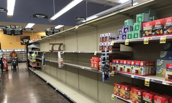 The toilet paper and paper towel aisle at Ralphs in Menifee, Calif., on March 15. 2020. (Brad Jones/The Epoch Times)