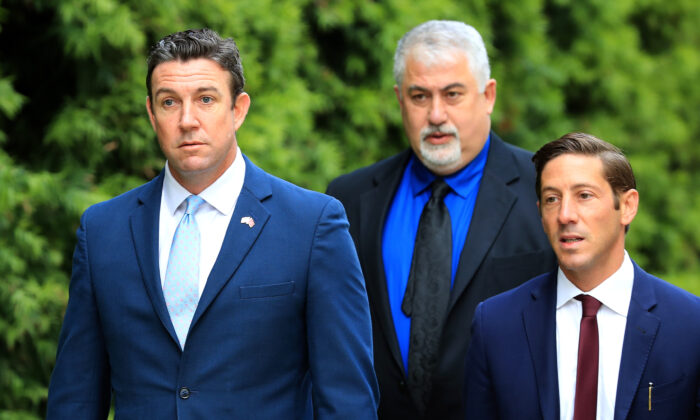 Former Rep. Duncan Hunter (R-Calif.) (L) walks into the Edward J. Edward J. Schwartz Federal Courthouse to be sentenced on corruption charges in San Diego, Calif., on March 17, 2020. (Sean M. Haffey/Getty Images)