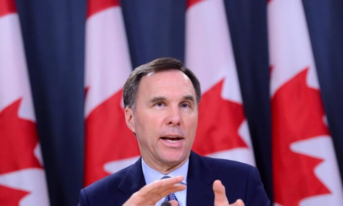 Minister of Finance Bill Morneau takes part in a press conference at the National Press Theatre in Ottawa on March 13, 2020. (The Canadian Press/Sean Kilpatrick)
