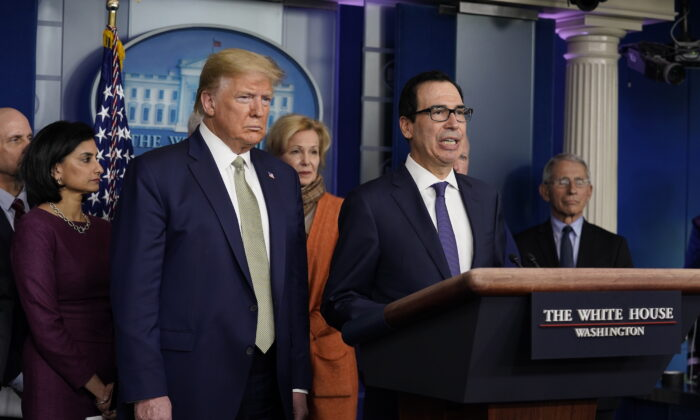 Treasury Secretary Steven Mnuchin speaks during a press briefing with the coronavirus task force as President Donald Trump looks on, at the White House, in Washington, on March 17, 2020. (Evan Vucci/AP Photo)