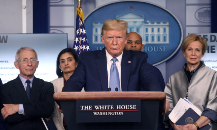 President Donald Trump holds a news briefing on the coronavirus outbreak while accompanied by members of the coronavirus (COVID-19) task force at the White House in Washington, on March 16, 2020. (Leah Millis/Reuters)