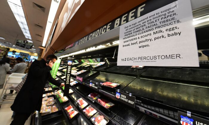 A sign posted announces two-items per customer for certain items as people shop for food at a Ralph's Supermarket in Monterey Park, California, on March 16, 2020. (Frederic J. Brown/AFP via Getty Images)