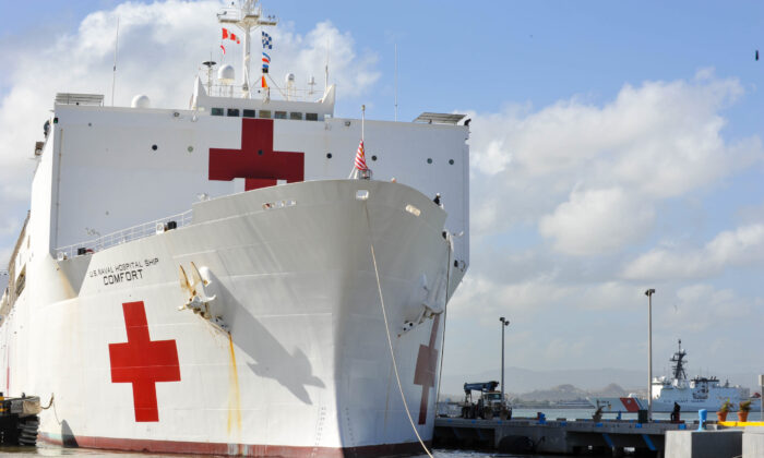 The Military Sealift Command hospital ship USNS Comfort (T-AH 20) arrives in San Juan, Puerto Rico on Oct. 3, 2017. (U.S. Air Force Capt. Christopher Merian/U.S. Navy via Getty Images)